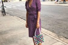 14 a printed purple wrap over the knee dress, a colorful bag and brown shoes with square toes