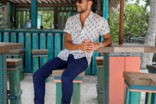14 a relaxed holiday look with bright blue chinos, a printed short-sleeve shirt, bright red loafers