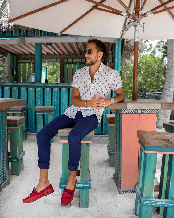 a relaxed holiday look with bright blue chinos, a printed short-sleeve shirt, bright red loafers