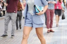 14 a serenity blue short suit, a white partly sheer top, a colorful clutch, statement earrings and blue block heels
