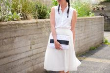 14 a sleeveless white button down, a matching midi skirt, white dad sandals with a small clutch
