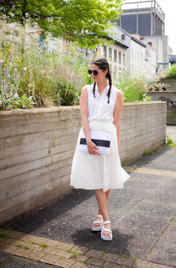 a sleeveless white button down, a matching midi skirt, white dad sandals with a small clutch