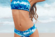 14 a super bright blue and white tie dye bikini with a halter neckline and a back on straps