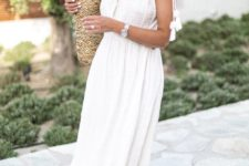 14 a white sleeveless linen midi dress with a plunging neckline, tassels, brown slippers and a straw bag