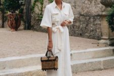 15 a creamy linen maxi dress with pockets, a straw chest bag and nude bow shoes