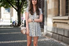 15 a white printed mini dress, white dad sandals, a metallic bag for a casual and comfy look