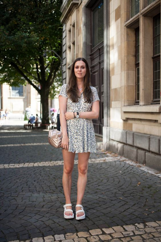 a white printed mini dress, white dad sandals, a metallic bag for a casual and comfy look
