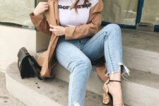 15 blue distressed jeans, a white printed tee, a camel jacket, printed mustard shoes with square toes