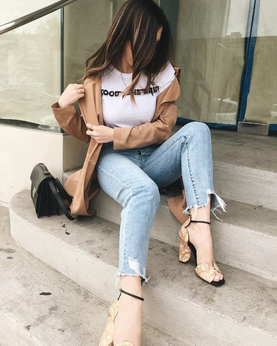 blue distressed jeans, a white printed tee, a camel jacket, printed mustard shoes with square toes