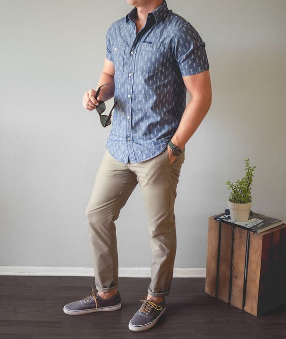 tan pants, a blue printed button down with short sleeves, grey sneakers will give you a caual feel