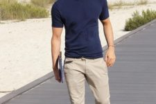 16 a simple summer outfit with a navy tee, tan pants and black loafers