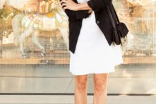 16 a white over the knee dress, a black blazer, black ankle strap shoes and a black bag