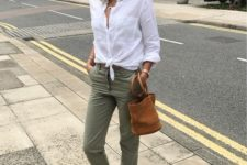 16 olive green pants, a white button up, brown leather square toe sandals and a matching bucket bag