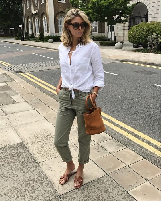 olive green pants, a white button up, brown leather square toe sandals and a matching bucket bag