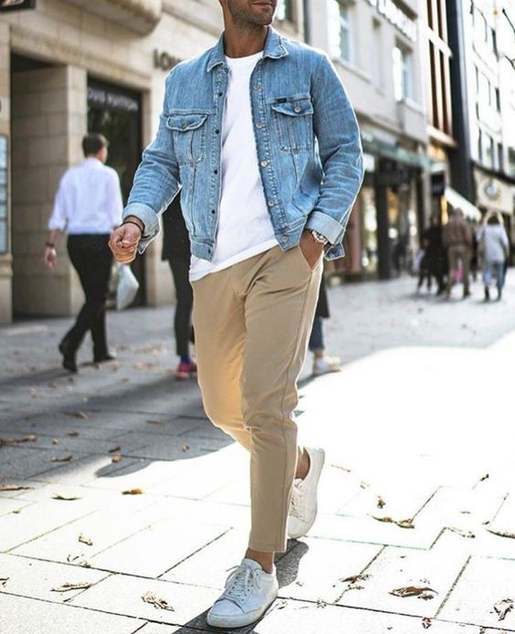 a cool late summer look with tan pants, a white tee, white sneakers, a denim jacket for a casual and comfy summer look