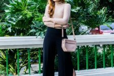 With beige blouse, leather bag and black high heels