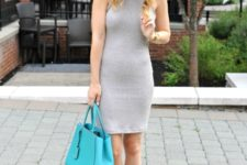 With beige lace up sandals and turquoise tote bag