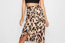 With black crop top and black ankle strap heels