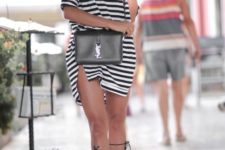 With black crossbody bag and lace up sandals