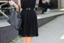 With black leather bag and ankle strap shoes