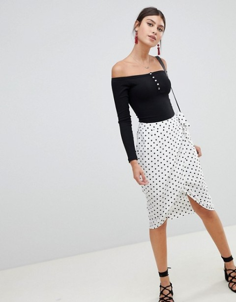 With black off the shoulder top, lace up shoes and bag