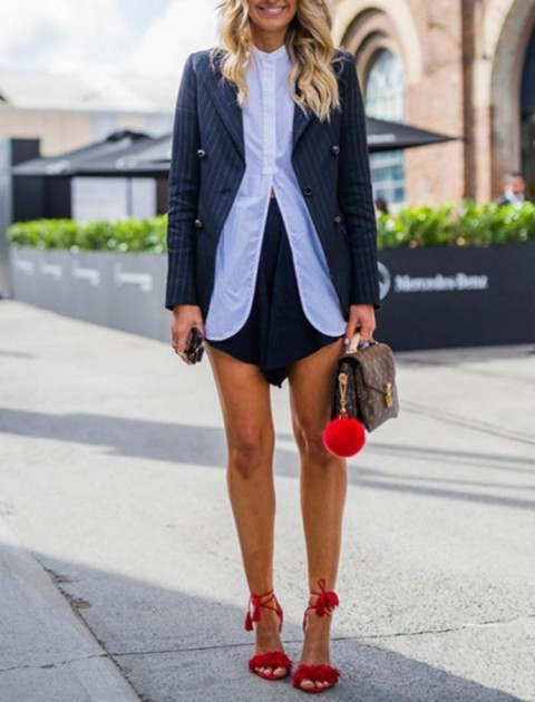 With black skirt, blouse, blazer and small bag