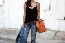 With black top, denim jacket, brown leather tote bag and heels