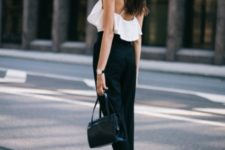 With black trousers, black bag and flat shoes