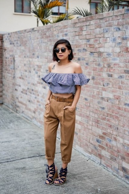 With brown cuffed pants and lace up sandals
