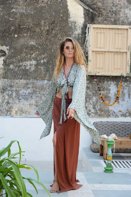 With brown maxi skirt and flat sandals