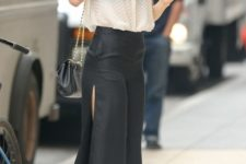 With button down shirt, chain strap bag and white pumps