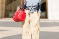 With button down shirt, red bag and high heels
