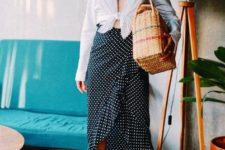With button down shirt, straw bag and beige shoes