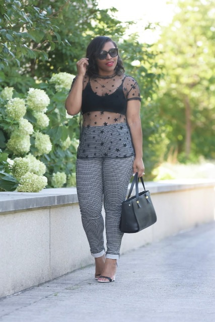 With checked trousers, black bag and sandals