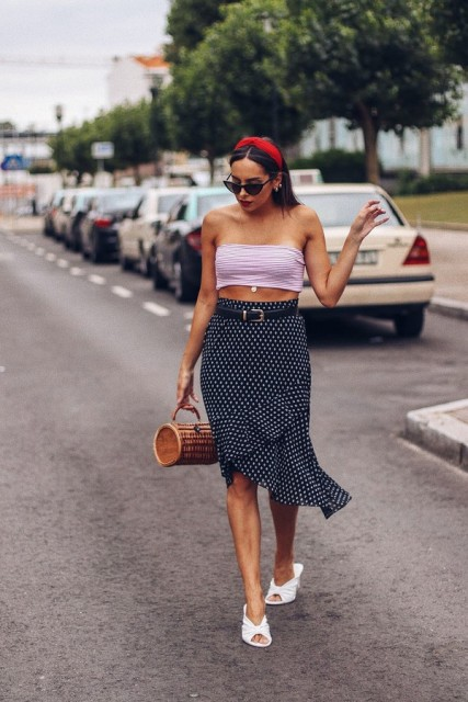 With crop top, straw bag and white sandals