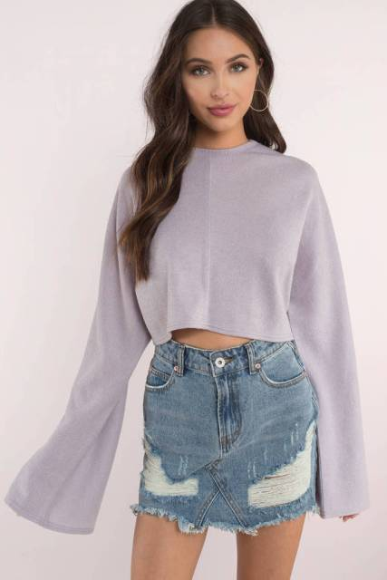 With denim distressed mini skirt