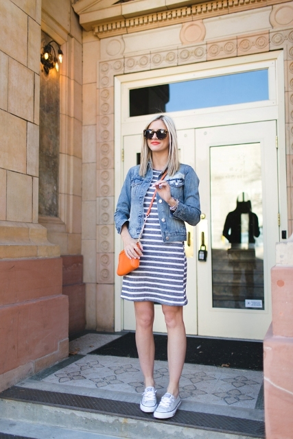 With denim jacket, orange crossbody bag and sneakers