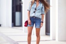 With denim shirt, denim shorts and red bag