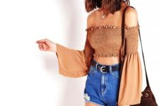 a crop top with distressed denim shorts