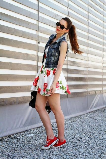 With denim vest, black bag and red sneakers