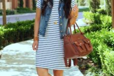 With denim vest, leather bag and white shoes