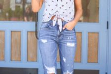 With distressed jeans and beige sandals