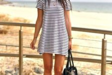 With embellished tote bag and white sneakers