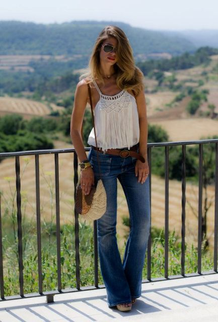With flare jeans, straw bag and platform sandals