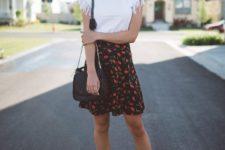 With floral skirt, black bag and black sandals