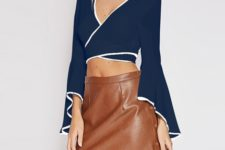 With gray boots and brown leather high-waisted skirt