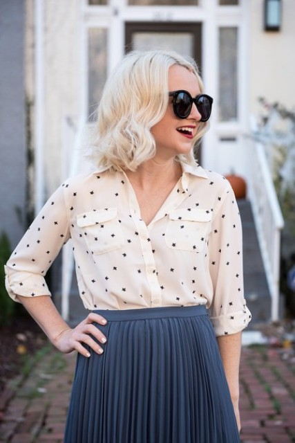 With gray pleated skirt and sunglasses