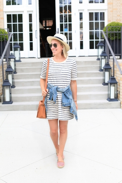 With hat, brown bag, denim jacket and striped flat shoes
