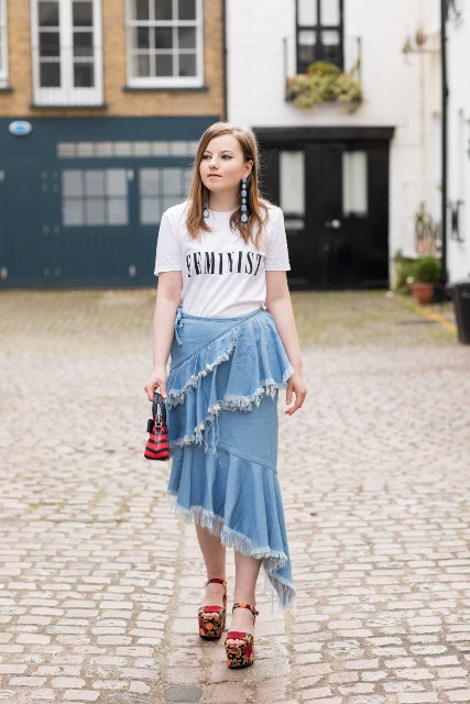 a distressed denim skirt with labeled t-shirt, printed platform shoes and mini bag