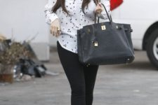 With leggings, tote bag and hot pink platform shoes